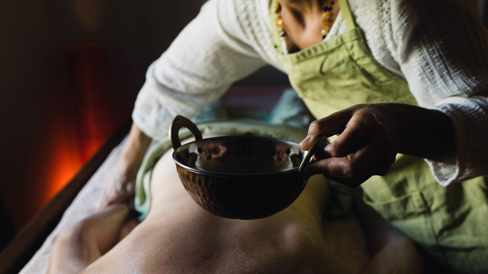Woman receiving an oil massage